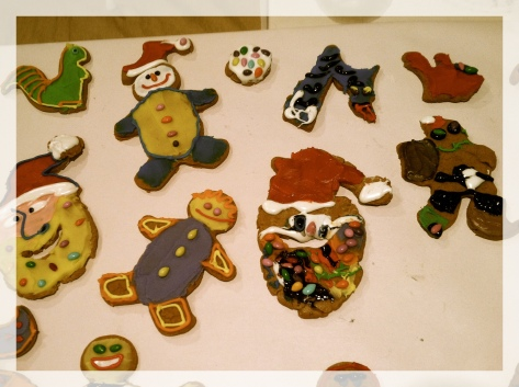 Smoke and neighbor Kathy's Christmas cookie art. Please note Smoke's psychedelic Santa, on offering tonight.